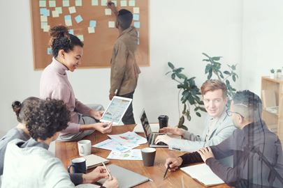 A group of yound people at a workshop in a meeting room